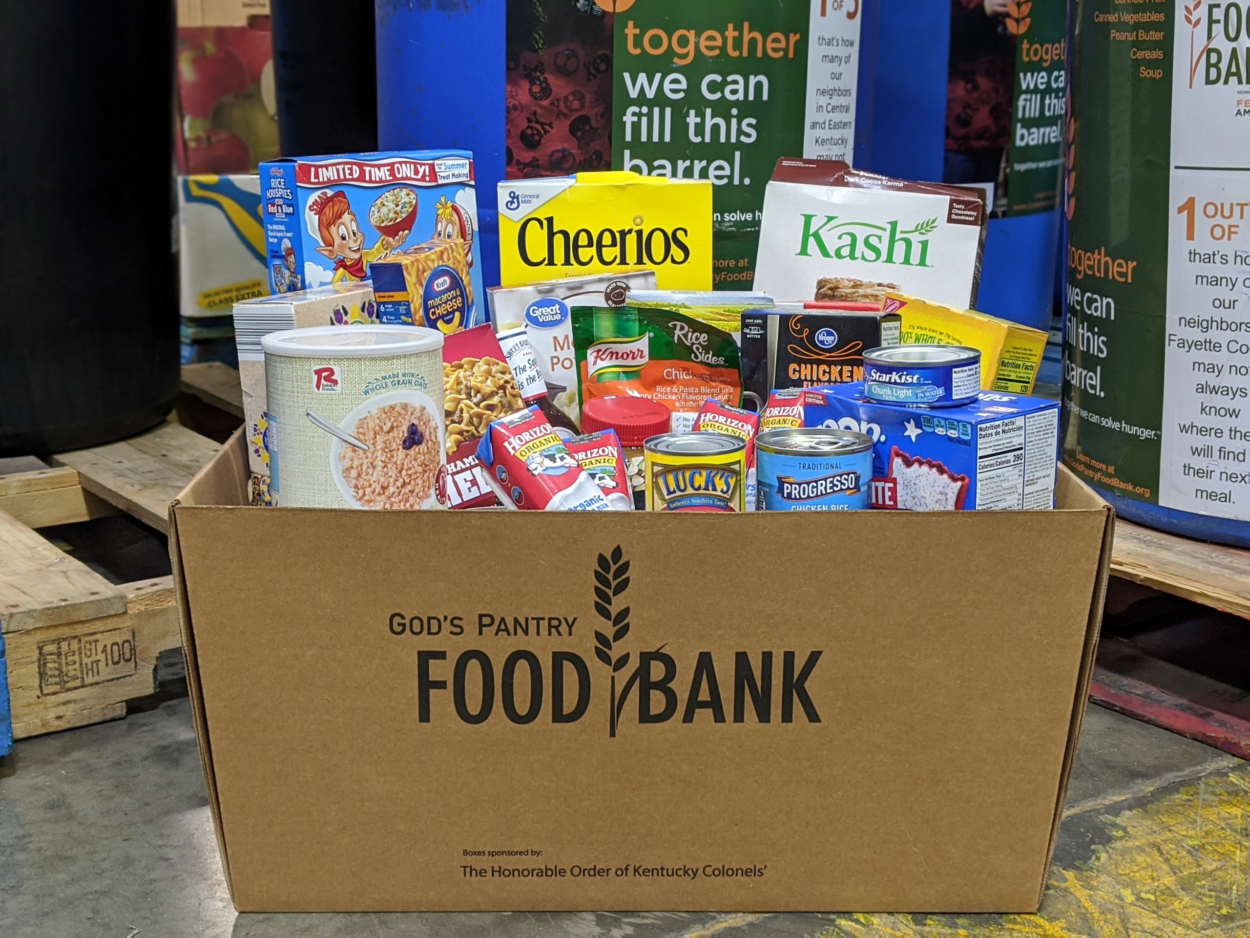 Branded food drive box filled with nonperishable items.